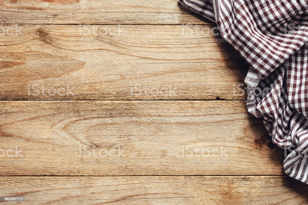 Wooden table background with textile. Food background stock photo