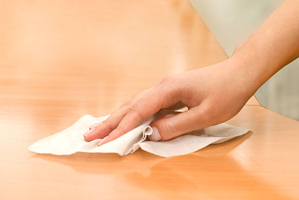 a wooden table being wiped off with a wet wipe  - rag stock pictures, royalty-free photos & images
