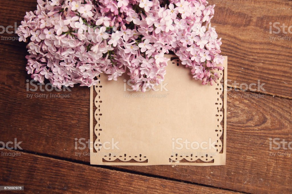 wooden table bouquet flowers of pink lilac stock photo