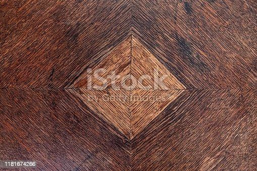 old furniture piece of dark wood with light brown square inlay