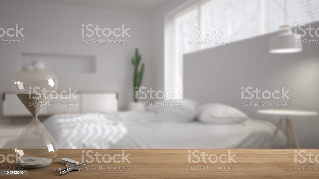 Wooden Table Desk Or Shelf With Crystal Modern Hourglass Measuring The Passing Time In A Countdown To A Deadline And House Keys Over Modern Bedroom Architecture Interior Design Copy Space Background Stock