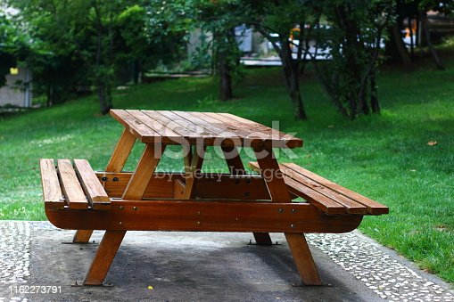 A wooden table for picnic at the park