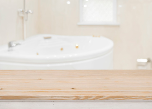 819534860 istock photo Wooden table for product display over defocused bathtub background 1138613610