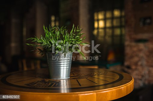 istock Wooden table in cafe on blurred Bokeh background 623452322