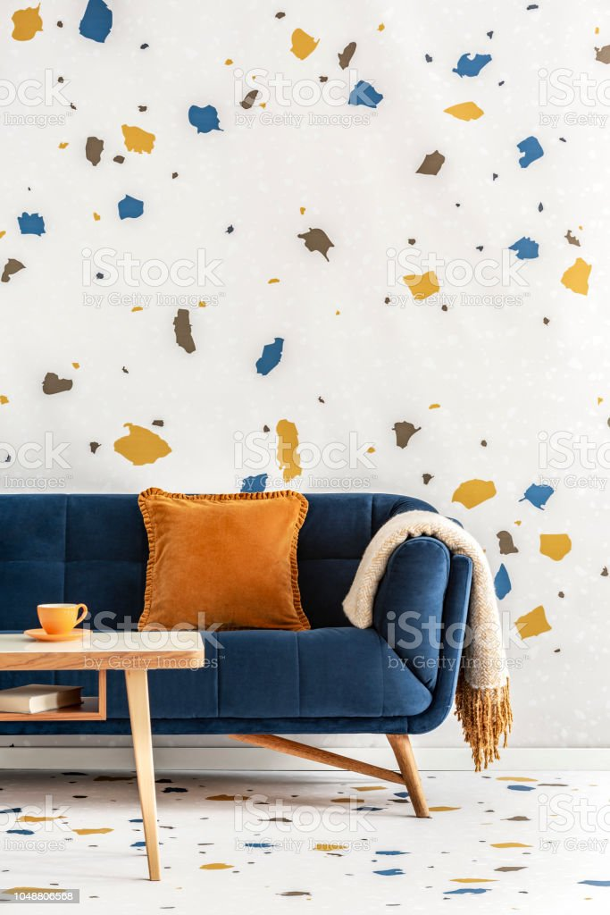 Astounding Wooden Table In Front Of Blue Couch With Orange Pillow In Theyellowbook Wood Chair Design Ideas Theyellowbookinfo