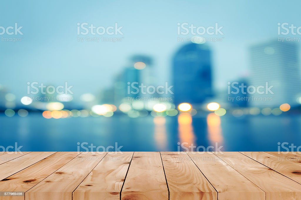 Wooden table in front of blurred landscape stock photo