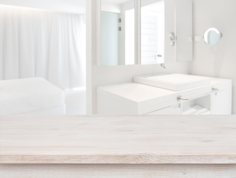 819534860 istock photo Wooden table in front of blurred resort room interior background 685469988