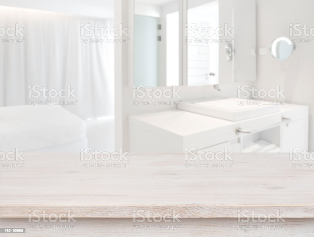 Wooden table in front of blurred resort room interior background stock photo