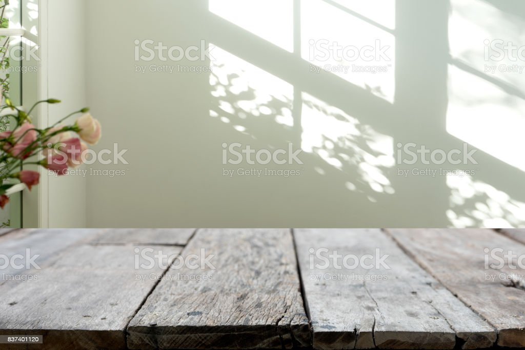 wooden table in front of the blur background stock photo