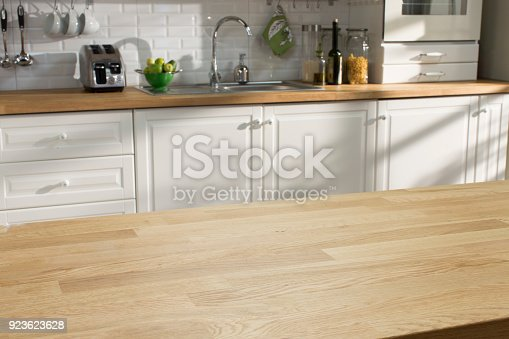 923629650istockphoto Wooden table in the kitchen 923623628