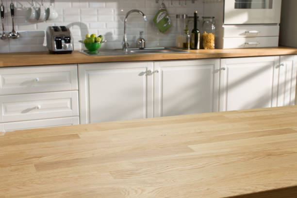 wooden table in the kitchen - kitchen counter stock photos and pictures