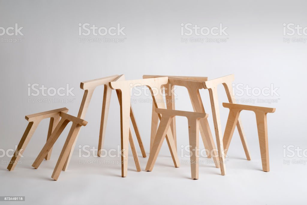Wooden Table Legs of Various Sizes on Gray Background stock photo