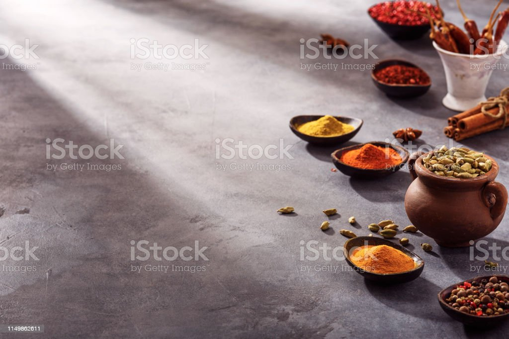 Wooden table of colorful spices, copy space for your content.