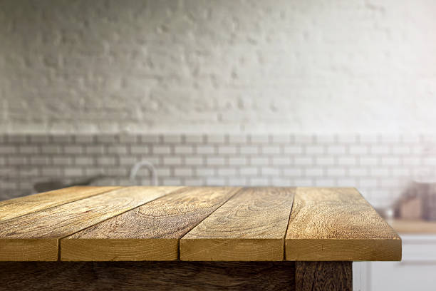 Wooden table on blurred background of kitchen stock photo