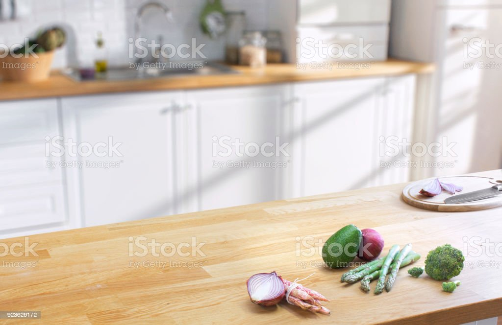 wooden table on blurred kitchen interior background stock