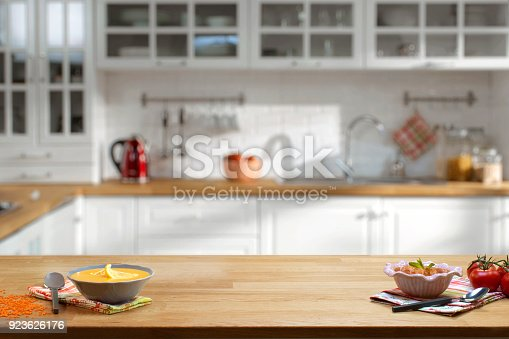 istock Wooden table on blurred kitchen interior background 923626176