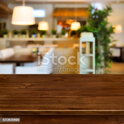 istock Wooden table on blurred room interior background 520805899