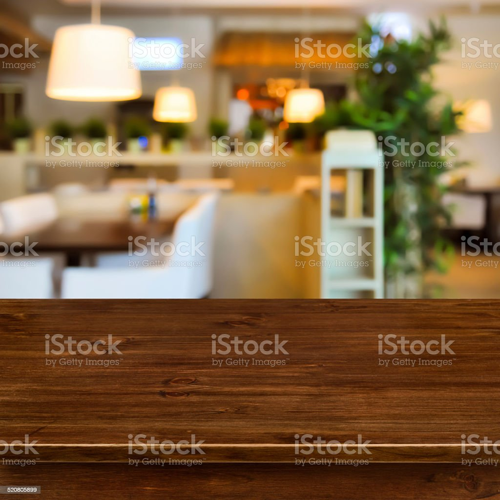 Wooden table on blurred room interior background stock photo