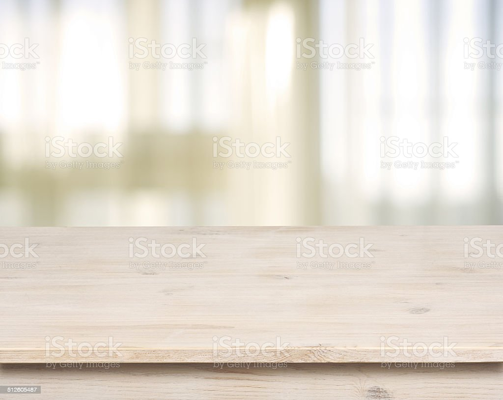 Wooden table on defocuced window with curtain background stock photo
