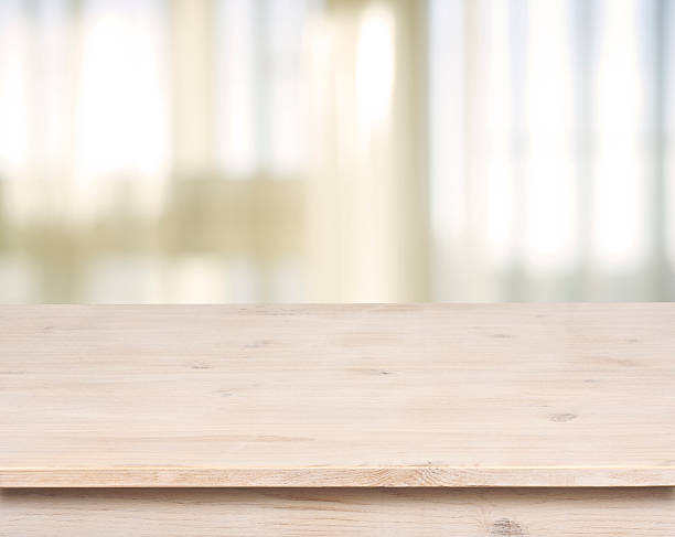 Wooden table on defocuced window with curtain background Wooden table on defocuced window with curtain background empty desk stock pictures, royalty-free photos & images