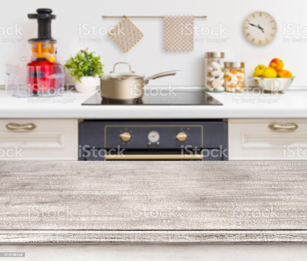 Wooden table on defocused kitchen bench with oven background stock photo