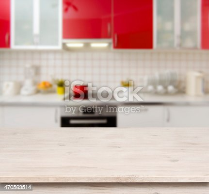 istock Wooden table on red modern kitchen bench interior background 470563514