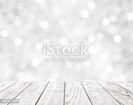 istock Wooden table on white abstract background 530427918