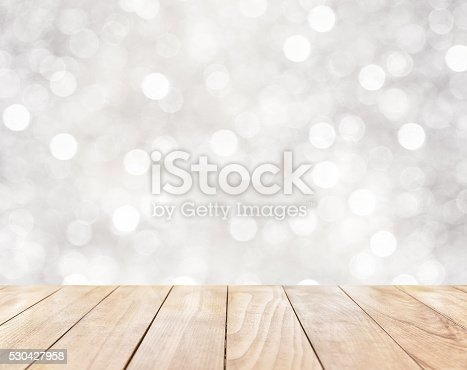 530427918 istock photo Wooden table on white abstract background 530427958