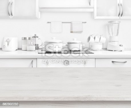 istock Wooden table on white modern kitchen interior background, pastel colors 582302232