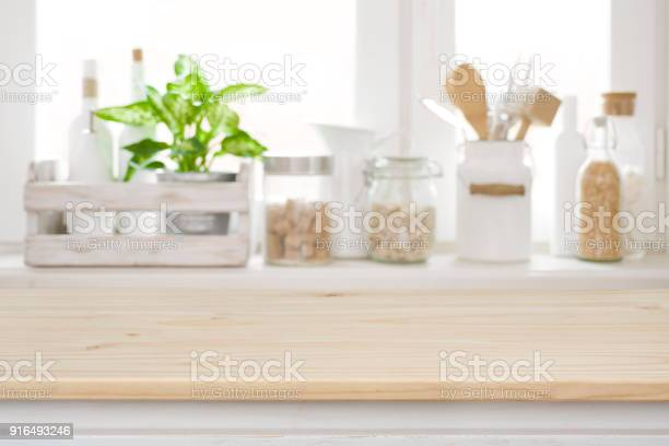 Wooden table over blurred kitchen window sill for product display picture id916493246?b=1&k=6&m=916493246&s=612x612&h=rmmdl9gfu3ox7ziogck4erzlezpmj 0ykwwkvw85g4q=