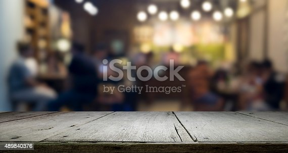istock Wooden table platform and bokeh at night for present product 489840376