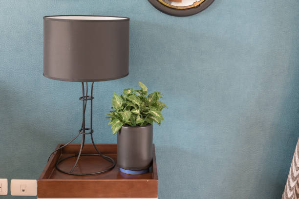 wooden table side with modern lamp stock photo