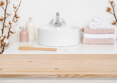 819534860 istock photo Wooden table top and blur bathroom interior on the background 1132720100