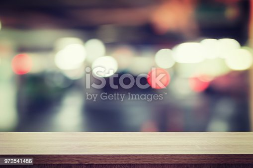 862429776 istock photo Wooden table top and bokeh night display montage for product with space. 972541486