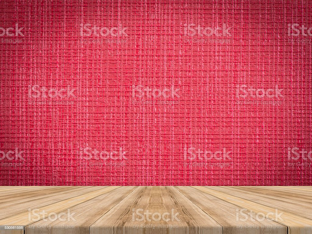 Wooden table top at tropical leather texture wall. stock photo