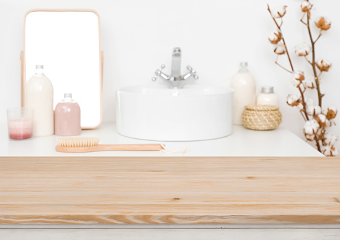 819534860 istock photo Wooden table top for product display and blurred bathroom background 1132720144