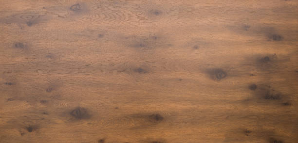 Wooden table top in dark timber stock photo