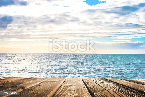 istock Wooden table top on blue sea and white sand beach 925084056