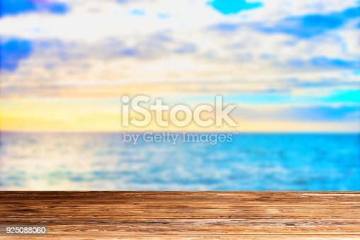istock Wooden table top on blue sea and white sand beach 925088060
