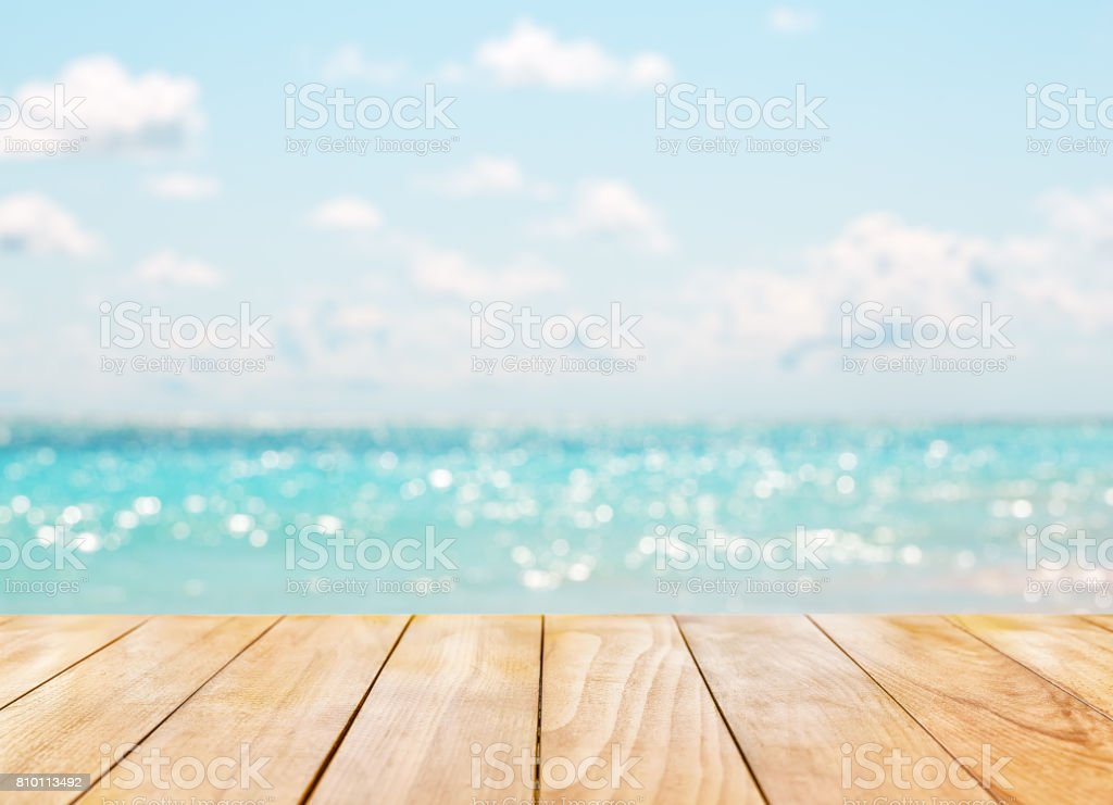 Wooden table top on blue sea stock photo
