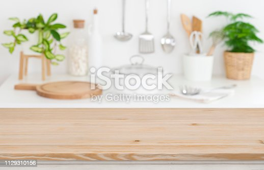 923629650istockphoto Wooden table top on blurred kitchen counter background 1129310156