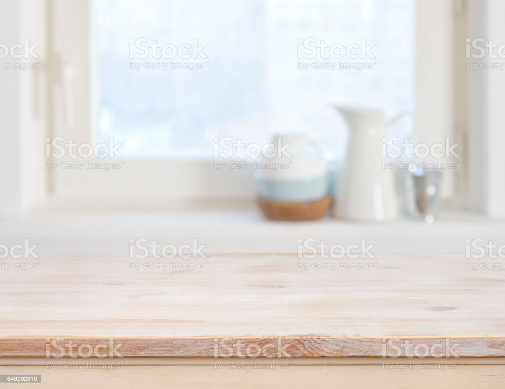 Wooden table top on blurred kitchen window background stock photo