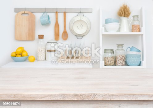665910118istockphoto Wooden table top on blurry decorated kitchen interior furniture background 956044674