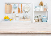 Wooden table top on blurry decorated kitchen interior furniture background