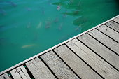 istock Wooden Table Top on green water 1153051179