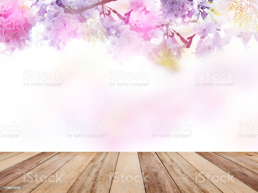 Wooden Table Top Over Abstract Floral Background Stock Photo