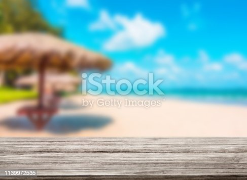 530427836 istock photo wooden table top with blur ocean background summer concept - Image 1139972535