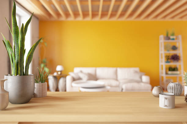 Wooden Table Top with Blur of Cozy Living Room stock photo