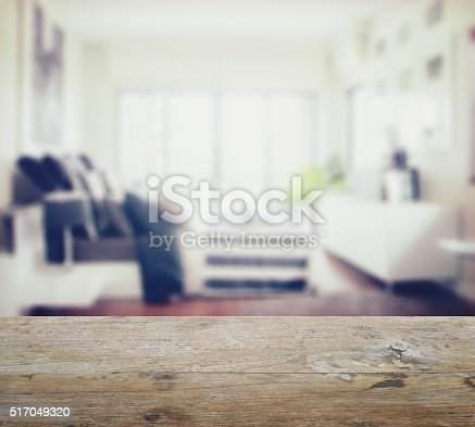 istock wooden table top with blur of modern bedroom interior 517049320