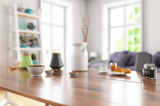 Wooden Table Top with Blur of Modern Living Room Interior. 3d Render